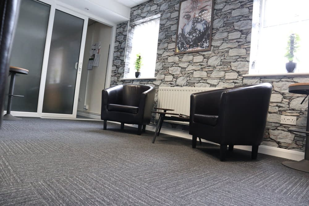 Hinckley Clinic image showing professional waiting room with two seats and a small table